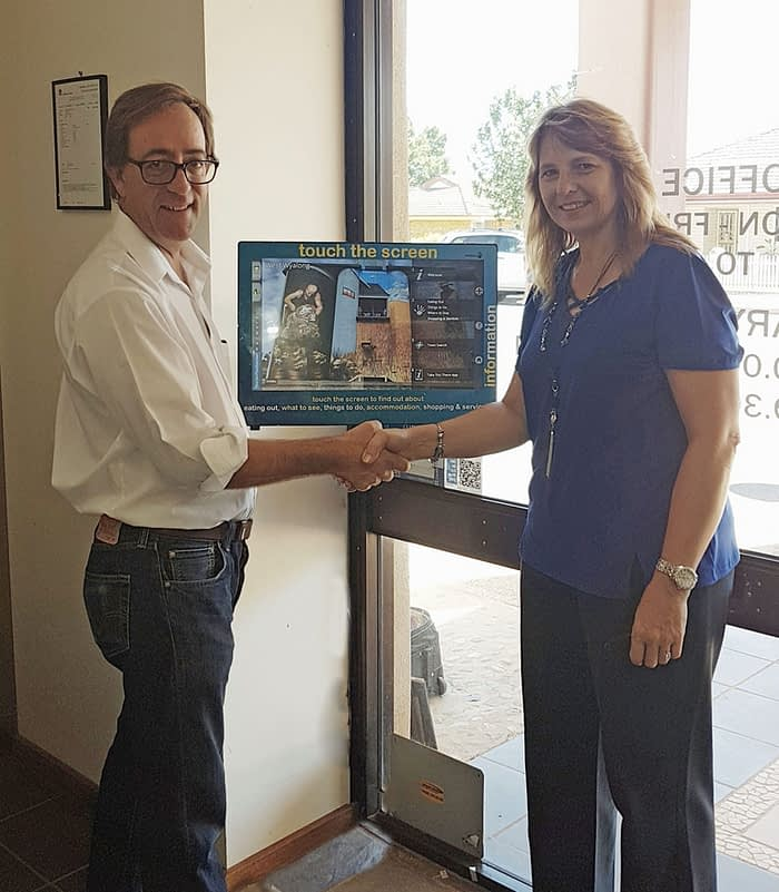 Datatrax CEO Paul Buckley and Marina Uys Office of the GM Bland Shire, handover the latest Touchscreen Technology